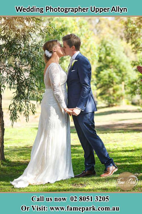 Photo of the Bride and the Groom kissing at the yard Upper Allyn NSW 2311