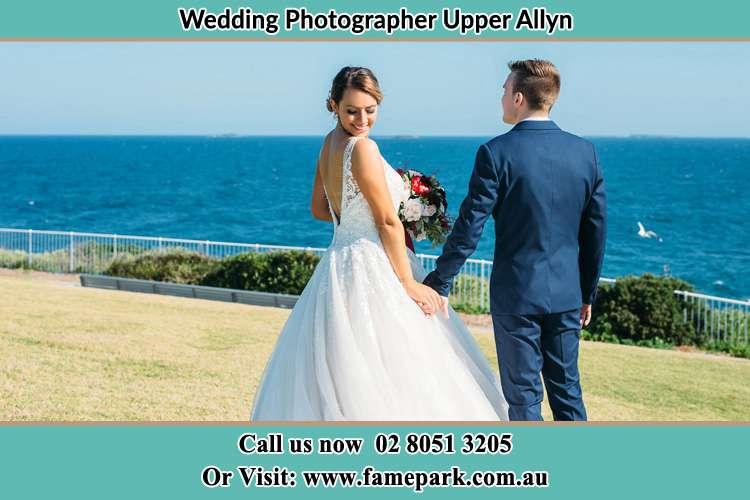 Bride and Groom walking near the shore Upper Allyn