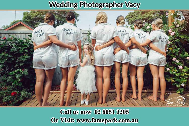 Behind photo of the Brides and the bridesmaids with the flower girl looking back Vacy NSW 2421
