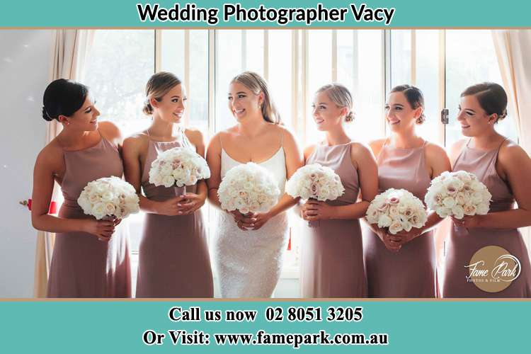 Photo of the Bride and the bridesmaids holding flower bouquet Vacy NSW 2421