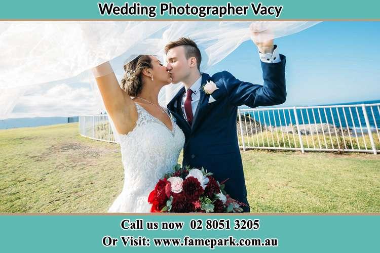 Bride and Groom Kiss near the shore Vacy