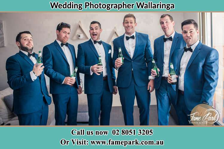 The groom and his groomsmen striking a wacky pose in front of the camera Wallarobba NSW 2420