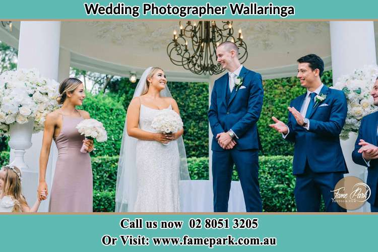 Photo of the Bride and the Groom happily looking each other with the secondary sponsors Wallarobba NSW 2420