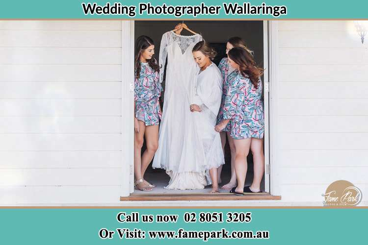 Photo of the Bride and her bridesmaids checking her bridal gown Wallaringa NSW 2420