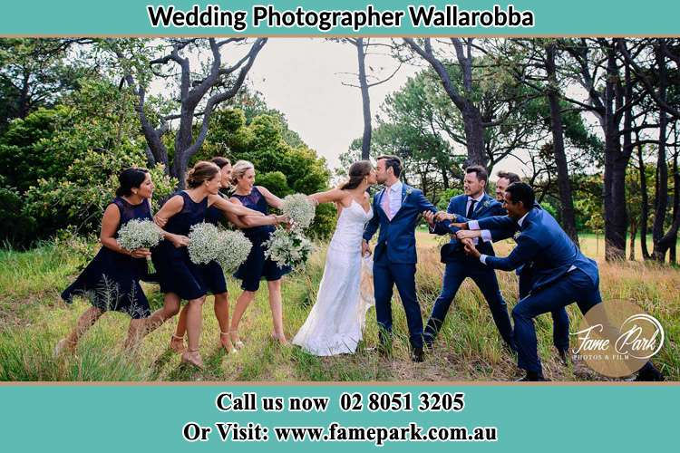 The bride and the groom was being pulled by their secondary sponsors Wallarobba
