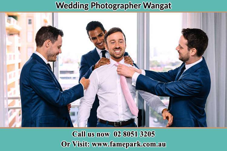 Photo of the Groom helping by the groomsmen getting ready for the wedding Wangat NSW 2420