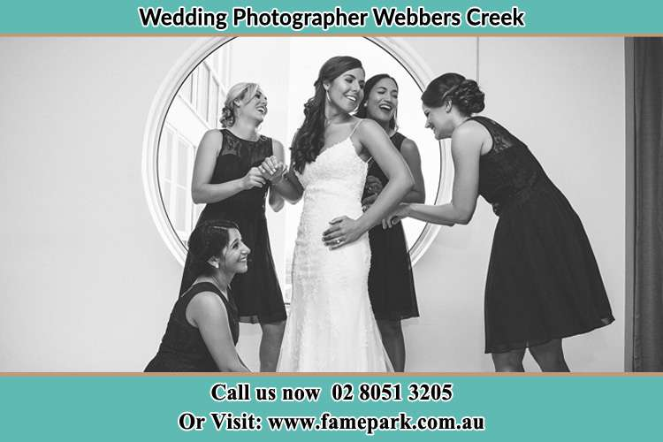 Bride getting ready near the window with her bride's maids Webbers Creek