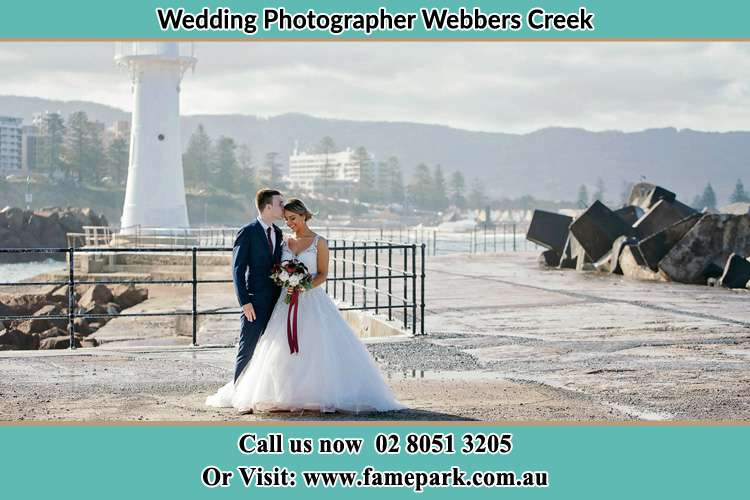 Bride and Groom near the shore and the watch tower Webbers Creek