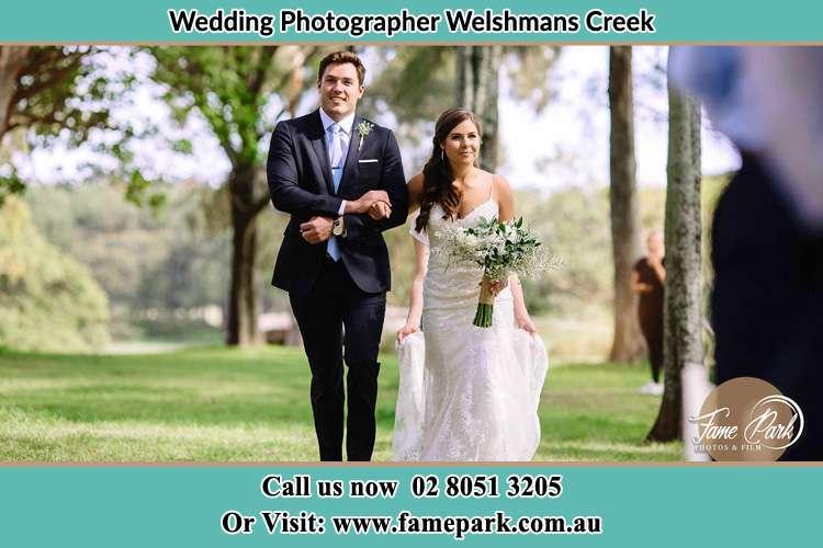 Bride and Groom walking in the garden Welshmans Creek