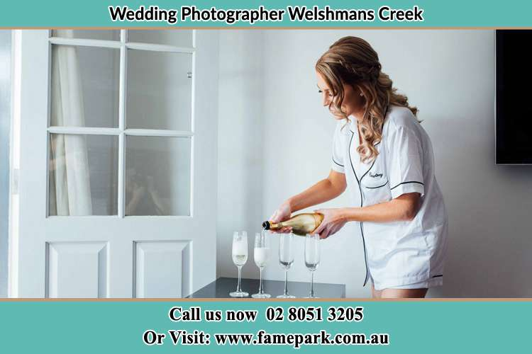 Photo of the Bride pouring wine to the glass Welshmans Creek NSW 2420