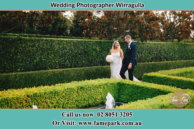 Photo of the Bride and the Groom walking the garden Wirragulla NSW 2420